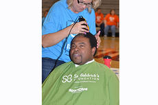 """<div class=""""source""""></div><div class=""""image-desc"""">A participant in last year's St. Baldrick's event gets his head shaved to help raise money for pediatric cancer research.</div><div class=""""buy-pic""""></div>"""