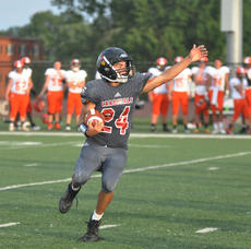 """<div class=""""source"""">photo/JOSH CLAYWELL</div><div class=""""image-desc"""">Taylor County&#039;s Wes Oliver looks for running room in Friday&#039;s game against Hart County.</div><div class=""""buy-pic""""><a href=""""/photo_select/67551"""">Buy this photo</a></div>"""