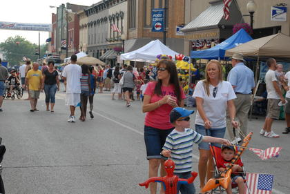 Many people browsed the booths on Main Street.