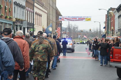 Veterans walk in the parade.