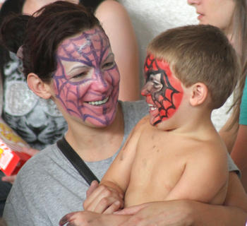 Beth and Dominic, 2, Visconti get matching spiderman face paints during the Circus Pages 25h Anniversary show Tuesday.
