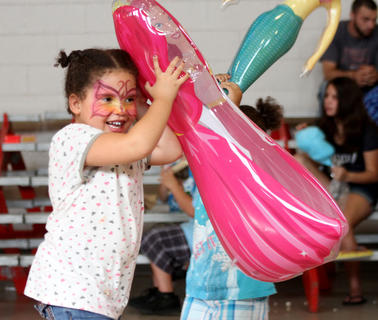 Chynna Wilkerson, 5, plays with her sister, Bailee, 3, and their new inflatable princesses.