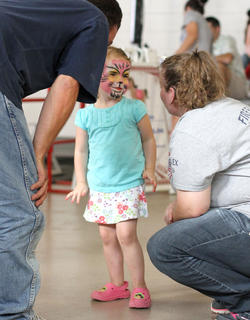 Nevaeh Spurlock, 3, shows off her freshly painted cat face.