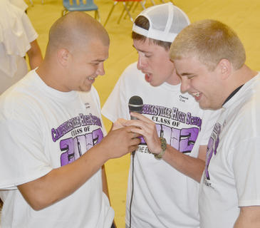 From left, Nicholas Lamer, Chance Cox and Josh Gaines sing karaoke.