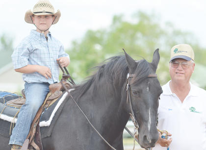 Chase Morris of Campbellsville rides his horse as his grandfather, Jim Noe of Campbellsville, leads them for the judges.