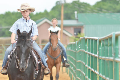 Chase Morris of Campbellsville rides his horse. Behind him is Kelsey Woodrum of Taylor County.