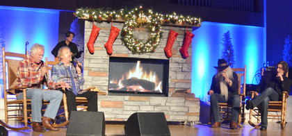 The Oak Ridge Boys sing classic Christmas songs as they sit in rocking chairs by the fireplace. From left are Joe Bonsall, Duane Allen, William Lee Golden and Richard Sterban.