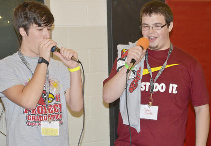 Nate Irwin, at left, and Caleb Smith sing karaoke.