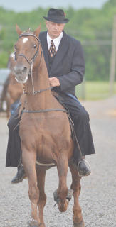 Though rain might have kept some participants away, the 10th anniversary Tommie Johns Memorial Championship Horse Show attracted competitors from Campbellsville and across the state. The show was Saturday night, the opening day of the Taylor County Fair. Above, Joe Allen Hays of Parksville rides in the Tommie Johns horse show.