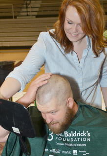 Brandon Lakes was one of many people who shaved their heads on Saturday as part of the community's seventh St. Baldrick's event at Campbellsville University to raise money for children's cancer research.