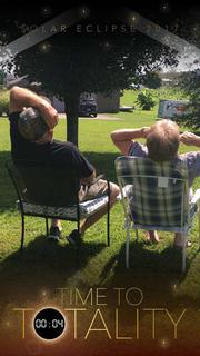 Submitted from the Facebook profile of Tonya Bogues Jerry and Diane Carter watching the eclipse
