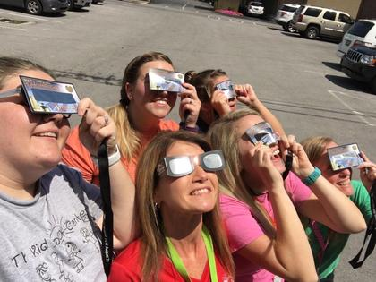Submitted from the Facebook profile of Marsha Herron The sun may not have been shining bright during the eclipse but the girls in the Finance Department at The Kid SpOt Center, LLC make it shine all the time!