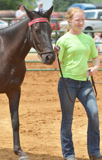 Mikaela Shoopman holds her horse as she is judged.