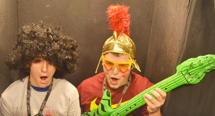 Cody Wood, at left, and Caleb Smith dress up and take photos together in the photo booth.