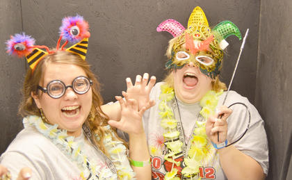 Taylor County High School Class of 2012 graduates celebrated together Friday, May 18, during a Project Graduation party. Students played games for points to spend at an auction for various prizes. Brooklyn Roby, left, and Jessie Bagby dress up and take photos together in the photo booth.