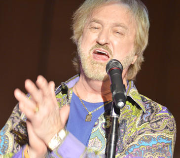 """Duane Allen claps as the audience sings along to """"Elvira."""""""