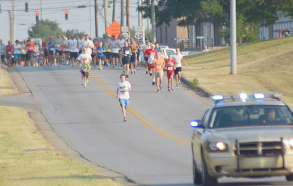 Campbellsville/Taylor County's Fourth of July Celebration kicked off on Saturday morning with a 5K run and walk. The overall male runner winner was Nathan Riggs. The female winner was Lauren Cox. The overall male walker winner was Brad Beltz. The female winner was Gail Godsey. Above, Nathan Riggs of Campbellsville gets a jumpstart at the race. He was the overall male runner winner.