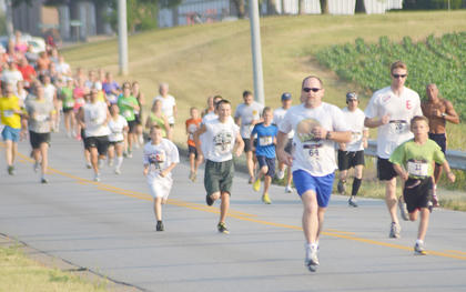 Holman Colvin of Campbellsville, No. 64, leads a pack of runners. Colvin came in first in the ages 45 to 49 category.
