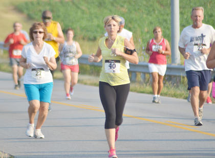 Tephanie White, No. 40, of Hodgenville, listens to music as she runs.