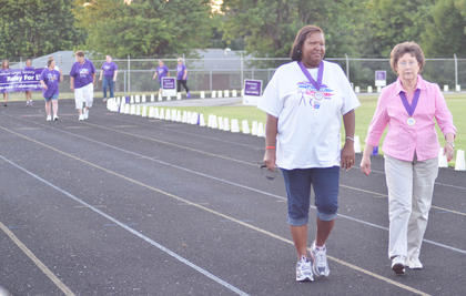 Cancer survivors take the first lap of the night.