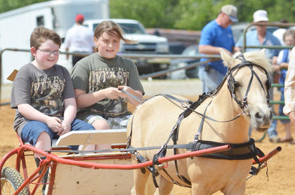 Cade Malone, at left, and his sister, Grace, of Campbellsville compete in the youth horse show.
