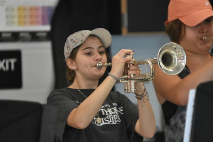 TCHS band member Izzy Curry plays trumpet during the first day of band camp.