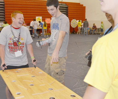 Austin Sprowles and Nolan Slinker laugh as they play a game.