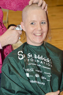 Gina Leigh is one of several women who shaved their heads on Saturday at the annual St. Baldrick's event at Campbellsville University to raise money for children's cancer research. Leigh shaved in honor of Sara Knifley, a member of her youth group who has battled cancer.