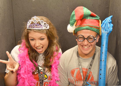Jessica Blakeman and Andrew Brockman dress up and take photos together in the photo booth.