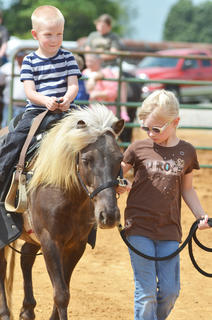 Hannah Marcum leads her horse, ridden by her brother Jacob, for the judges.