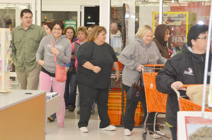 Big Lots shoppers hurry to find the items they want to buy.