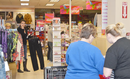 At Goody's, shoppers bought clothing, toys and home décor accessories on Black Friday morning.JCPenney shoppers go to the store before 6 a.m. on Friday in search of deals.