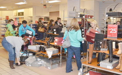 JCPenney shoppers go to the store before 6 a.m. on Friday in search of deals.