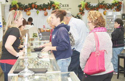 Shoppers at Tucker Diamonds and Gold take advantage of savings on Friday morning. Early birds got 50 percent off their purchases.