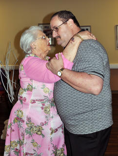 Robbie Bell, who served as prom escort, whirls resident Betty Jo Phillips around the dance floor at Bluegrass Way Assisted Living prom on Saturday.