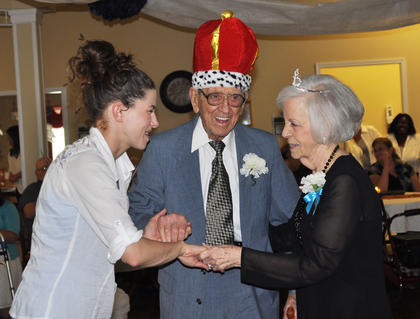 Brianne McKinney, activities coordinator, dances with prom king Milton Shuffett and prom queen Doris Holt at Bluegrass Way Assisted Living prom on Saturday.