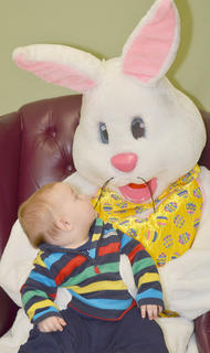 Roy Gribbins of Campbellsville gets a good look at the Easter Bunny.