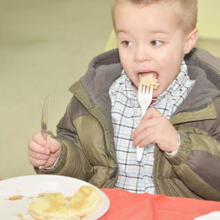 Benjamin Carrender of Campbellsville takes a big bite of his pancake.
