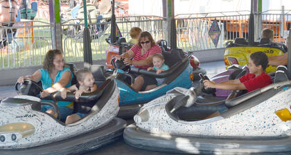 Children and adults alike have fun riding the bumper cars.