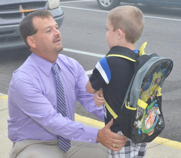 Campbellsville Independent School students headed back to the classroom on Thursday, Aug. 2, after summer break. Campbellsville Elementary School Principal Ricky Hunt greets a kindergarten student as he comes to his first day of school.