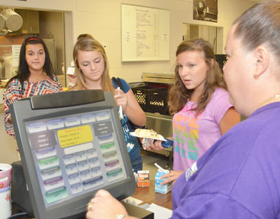 Campbellsville High School students wait in line at the cashier as they get their breakfast.