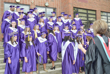Campbellsville High School guidance counselor Elisha Rhodes makes sure all 44 CHS graduates are in their final class photo.