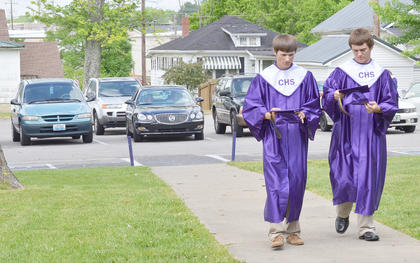 Chris Sexton, at left, and Josh Roe talk before graduation.