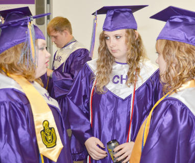 From left, Samantha Berry, Brandy Chelf and Angel Wise talk before Saturday's ceremony.