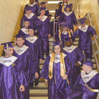 Forty-four students graduated from Campbellsville High School on Saturday. Here, the graduates walk to Hamilton Auditorium to get their diplomas.