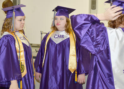 Angel Wise, at left, and Samantha Berry talk before the start of the graduation ceremony.