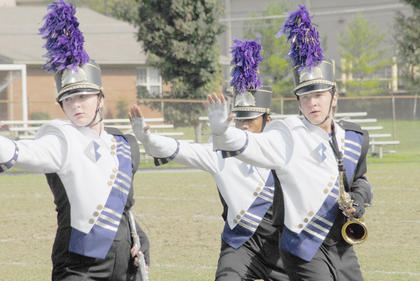 "Thirteen area bands competed at the annual Taylor County Marching Invitational on Saturday at Taylor County High School. CHS band members Abby Hieneman, who plays the flute, and saxophone players Kalup Cowan and Anthony Drew perform during the show ""Study in Motion."""