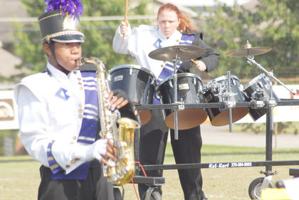 Thirteen area bands competed at the annual Taylor County Marching Invitational on Saturday at Taylor County High School. Percussionist Amie Leggett plays while Kalup Cowan marches.