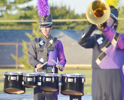 Dalton Adkins, drumline/pit player, marches with the CHS band.