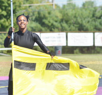 CHS color guard member Tanieshia Noyola performs with the CHS band.